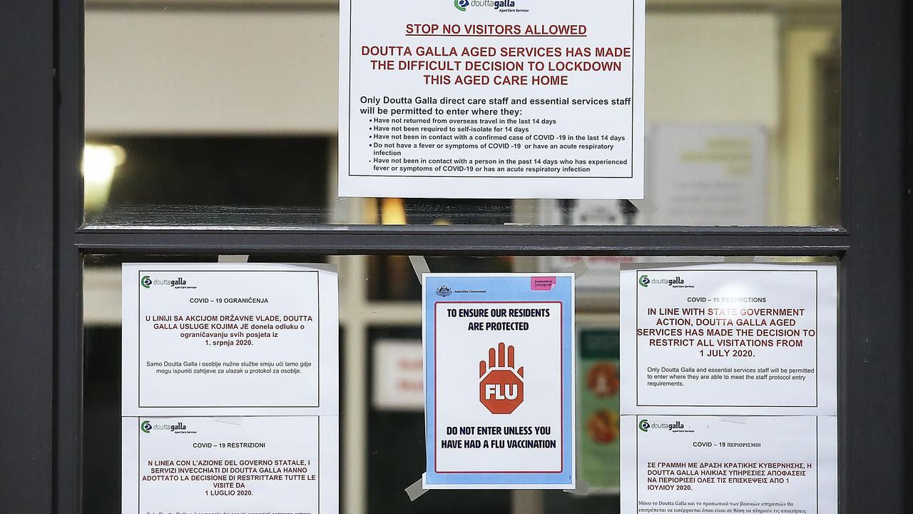 Warning signs at the entrance to the Doutta Galla nursing home in Yarraville. Picture: Ian Currie