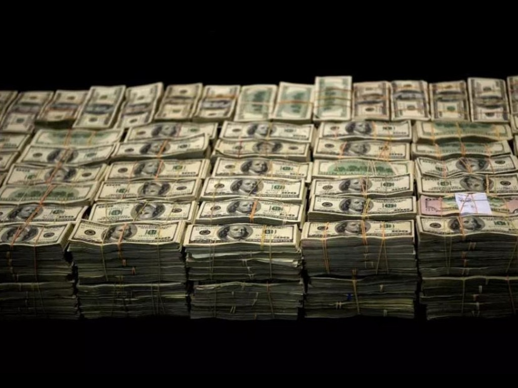 Pictured are bank notes forming part of a seizure of more than $US 15 million belonging to the Sinaloa cartel.