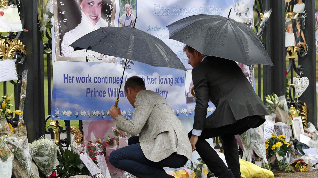Prince William and Prince Harry viewed tributes left by members of the public. Picture: Kirsty Wigglesworth/AFP