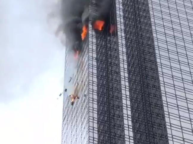 Fire is seen on a side of Trump Tower in New York on Saturday, April 7, 2018. Picture: Peter Thomas Roth / Twitter @PeterThomasRoth