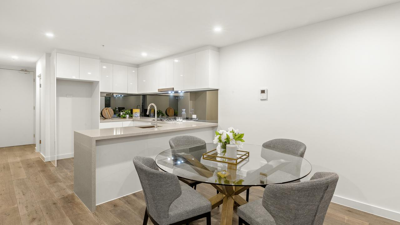 Open-plan living spaces as well as return benches in the kitchen also add to the appeal.