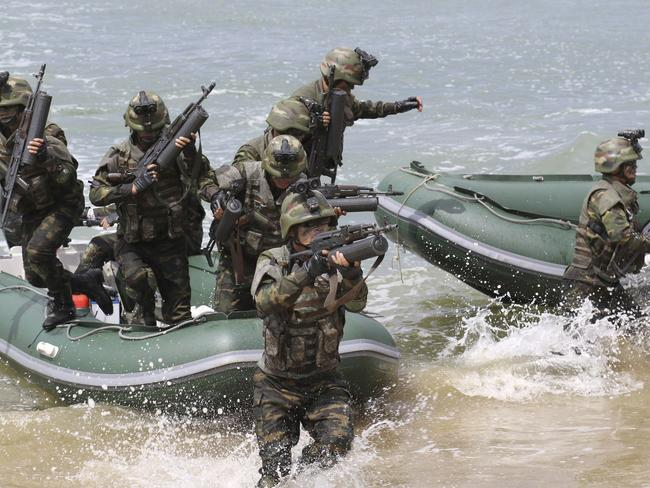 The North Korean government released this picture on Saturday showing special operation forces training as part of simulated attacks on South Korean islands. Picture: Korean Central News Agency/Korea News Service/AP