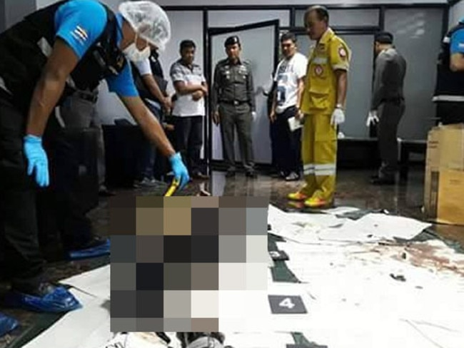 Thai forensic officers inspect the corpse which had been cut into six pieces and stored in garbage bags inside an industrial-sized freezer.