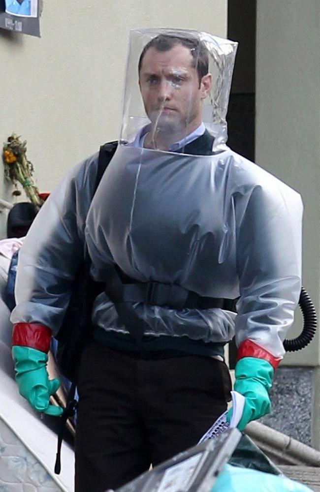 Jude Law is seen wearing a hazmat suit in Contagion. Picture: Supplied