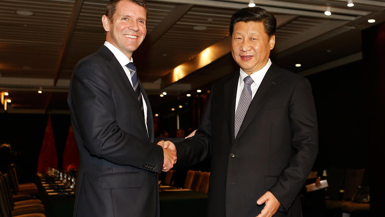 Xi Jinping shakes hands with then-New South Wales Premier Mike Baird during the meeting in Sydney. Picture: AAP/ Daniel Munoz