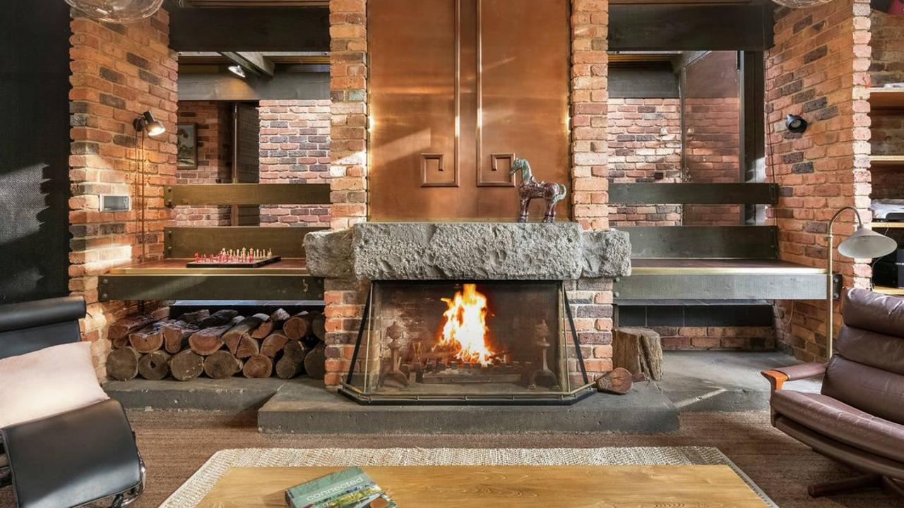 A copper and stone fireplace features.