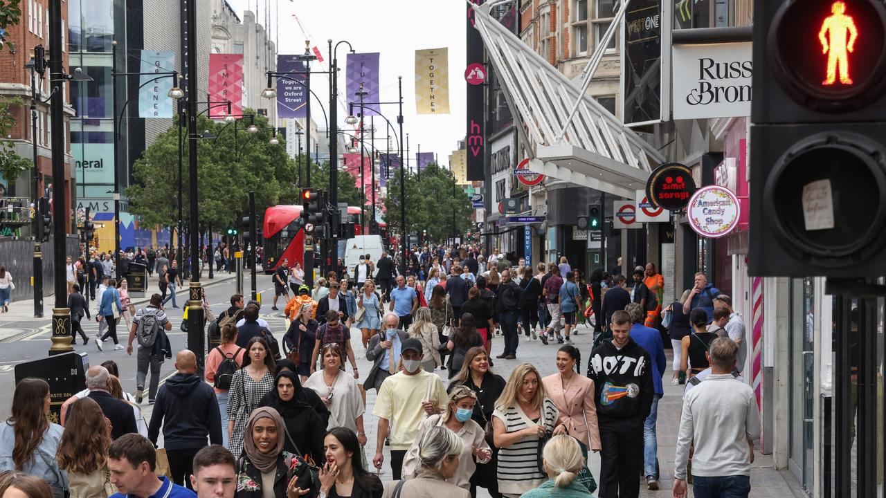 Crowds throng London's Oxford Street in August with the nation now living with Covid-19. Photographer: Hollie Adam/Bloomberg via Getty Images