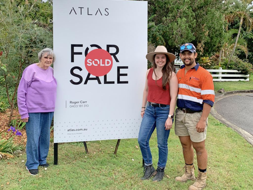 Rosemary Bartlam with first-time home buyers Madeline Pike-Moran and partner Josh Cawse who say they intend to live in the house and maintaining the yard. Picture: Supplied