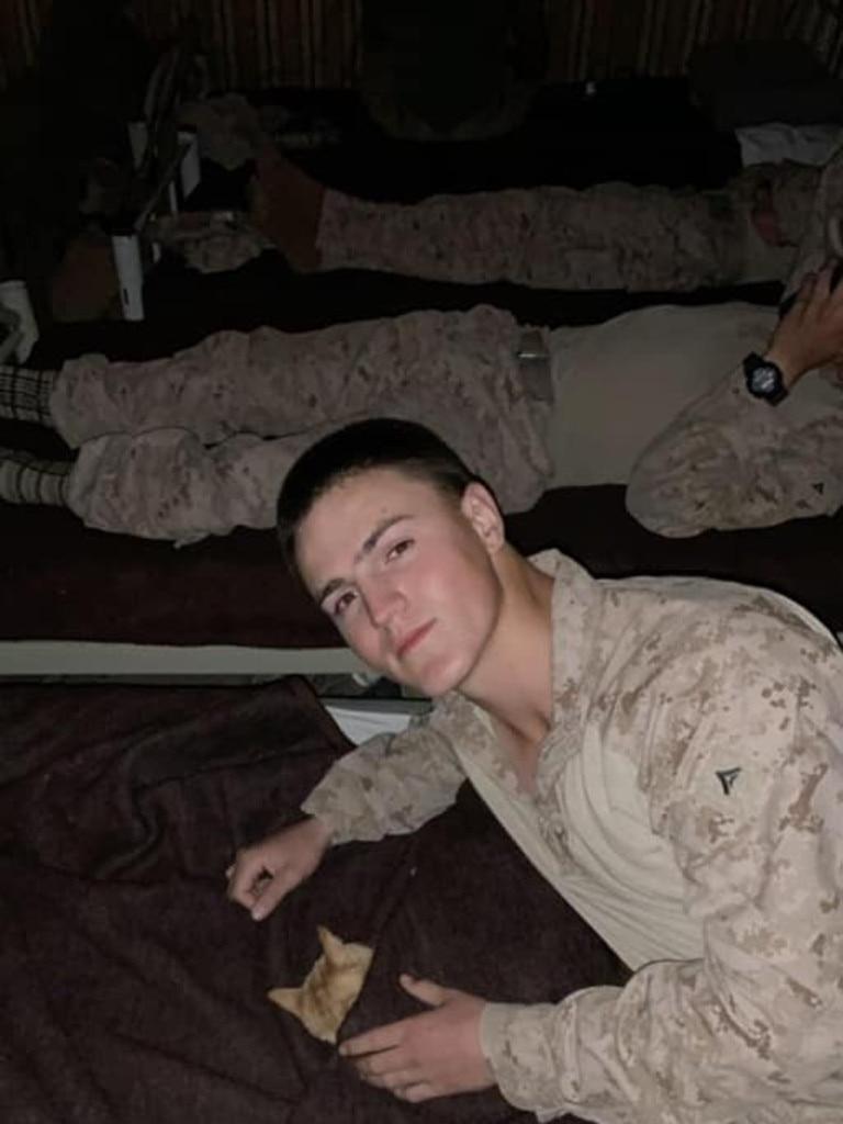 McCollum tucks a kitten into his bed.