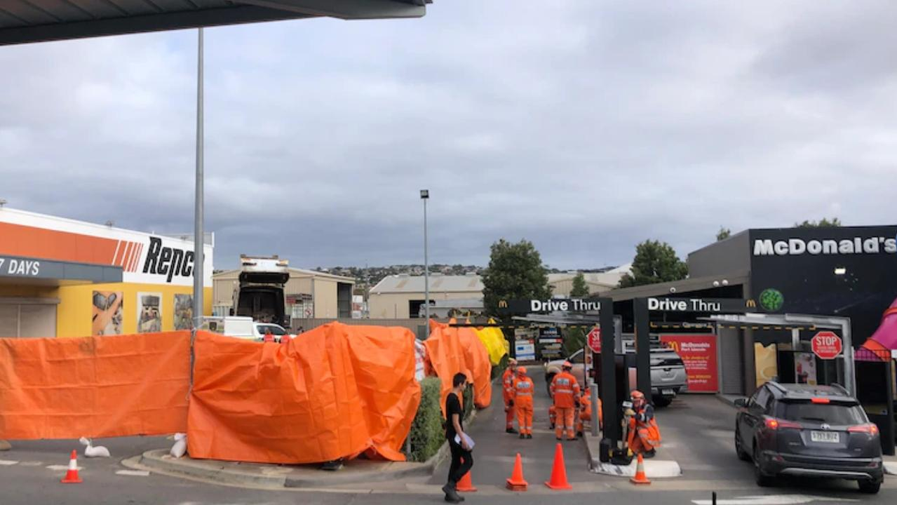 Emergency services were called to the Repco carpark next to the drive-through of a McDonald's outlet on Liverpool Street just after 5.20am. Picture: ABC News/Evelyn Leckie